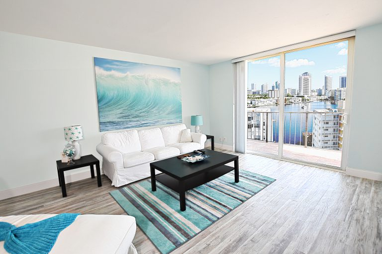 Photo By Mar10Photography of LivingRoom View of PierView and City